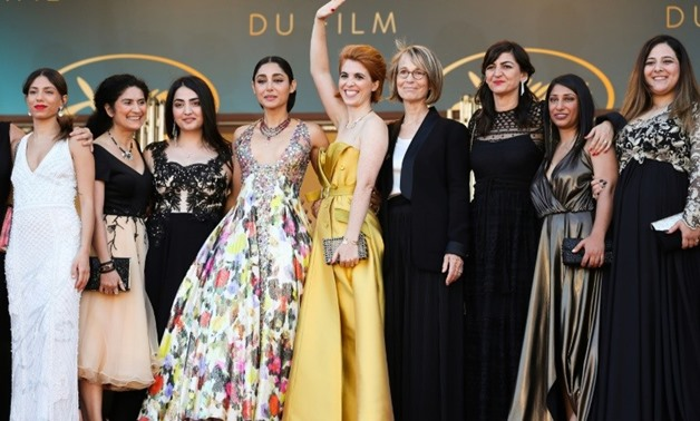 """Director Eva Husson (centre), Swedish actress Evin Ahmad (left),Iranian actress Golshifteh Farahani (4th right), producer Didar Domehri (3rd right) pose with French Culture Minister Francoise Nyssen (4th right) at screening of """"Girls of the Sun (Les Fille"""