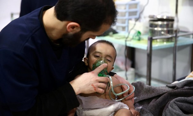 Man with a child are seen in hospital in the besieged town of Douma, Eastern Ghouta, Damascus, Syria February 25, 2018. Picture taken February 25, 2018 -  REUTERS