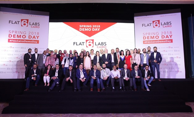 Minister of Investment Sahar Nasr stands between Flat6Labs Cairo Spring 2018 Demo Day 10 startup graduates, May 14, 2018 – Press Photo