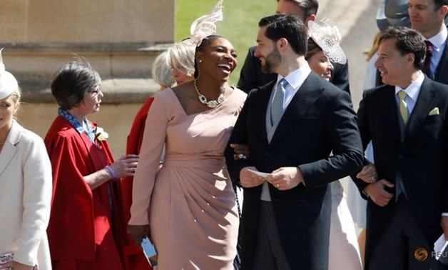Meghan Markle's friend, US tennis player Serena Williams (CL) and her husband US entrepreneur Alexis Ohanian (CR) arrive for the wedding ceremony of Britain's Prince Harry, Duke of Sussex and US actress Meghan Markle at St George's Chapel, Windsor Castle,