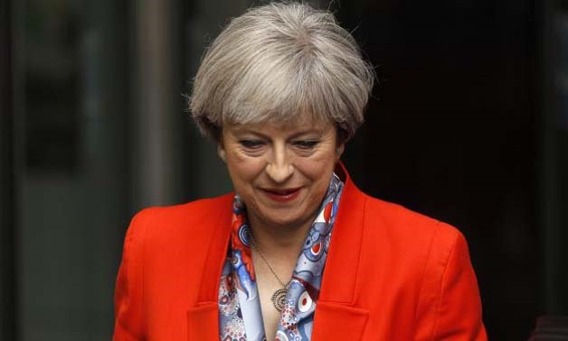 Britain's Prime Minister Theresa May leaves the BBC - Reuters