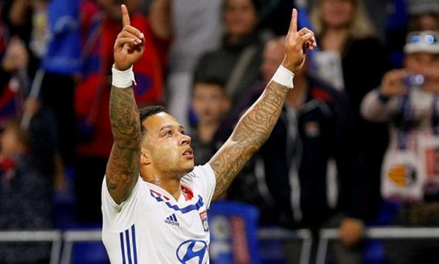 Soccer Football - Ligue 1 - Olympique Lyonnais vs OGC Nice - Groupama Stadium, Lyon, France - May 19, 2018 Lyon's Memphis Depay celebrates scoring their second goal REUTERS/Emmanuel Foudrot