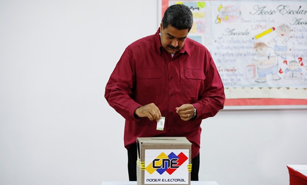 Venezuela's President Nicolas Maduro casts his vote at a polling station, during the presidential election in Caracas, Venezuela May 20, 2018. REUTERS/Carlos Garcia Rawlins