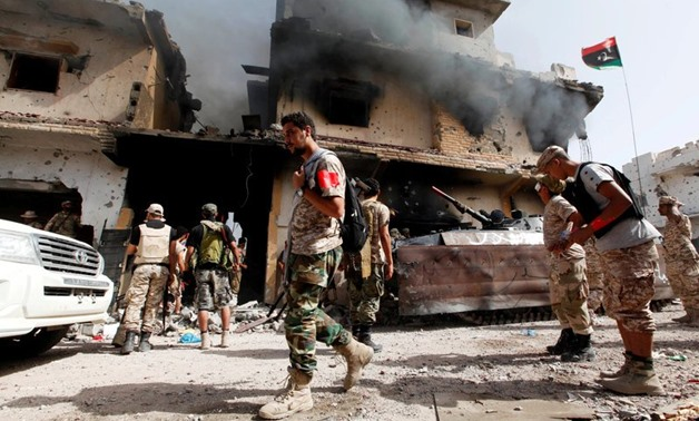 Smoke rises from a ruined house after it was hit by an air strike as fighters from Libyan forces allied with the U.N.-backed government advance into the last area controlled by Islamic State, in Sirte - REUTERS