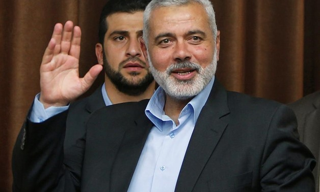 Senior Hamas leader Ismail Haniyeh waves as he arrives to deliver a farewell speech for his former position as a Hamas government Prime Minister, in Gaza City June 2, 2014. REUTERS