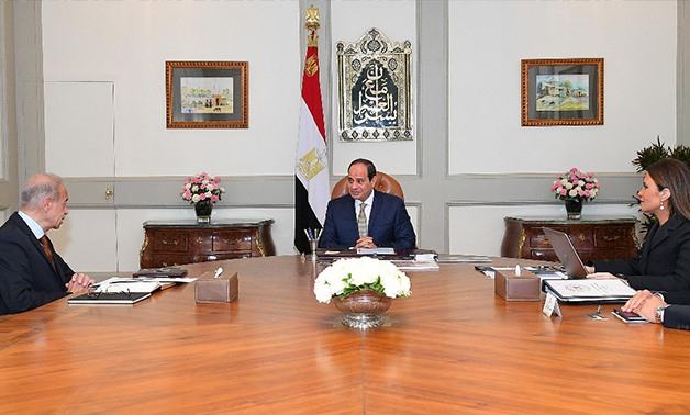 Egypt's President Abdel Fatah al-Sisi met with PM Sherif Ismail and Minister of Investment, Sahar Nasr - Press photo