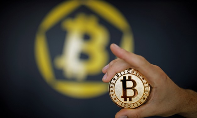 A Bitcoin (virtual currency) coin is seen in an illustration picture taken at La Maison du Bitcoin in Paris, France, June 23, 2017. REUTERS/Benoit Tessier/Illustration