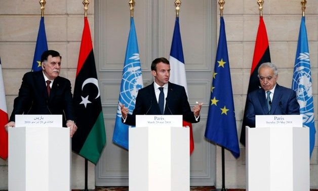 (From left) Libyan Prime Minister Fayez al-Sarraj, French President Emmanuel Macron and UN special envoy for Libya Ghassan Salame hold a press conference after four Libyan leaders agreed to hold elections in December
