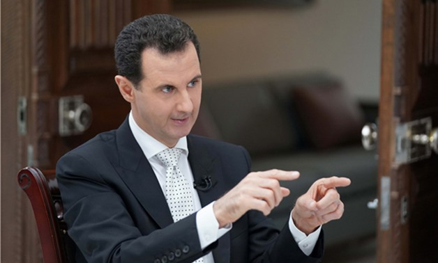 Syria's President Bashar al Assad gestures during an interview with a Greek newspaper in Damascus, Syria in this handout released May 10, 2018. SANA/Handout via Reuters