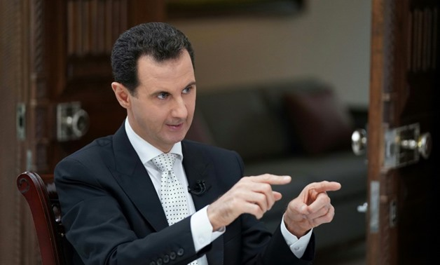A picture released by the official Syrian Arab News Agency on May 10, 2018 shows Syrian President al-Assad giving an interview to Greek Kathimerini newspaper in Damascus