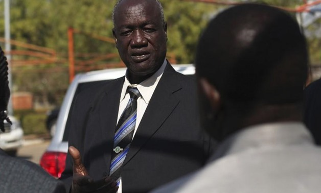 FILE PHOTO - South Sudan's Defence Minister Kuol Manyang Juuk, talks to cabinet members after a cabinet meeting in Juba January 17, 2014. REUTERS/Andreea Campeanu.