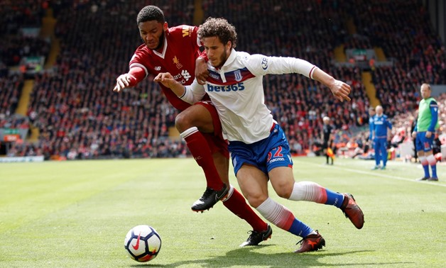 Soccer Football - Premier League - Liverpool v Stoke City - Anfield, Liverpool, Britain - April 28, 2018 Stoke City's Ramadan Sobhi in action with Liverpool's Joe Gomez Action Images via Reuters/Carl Recine
