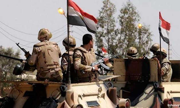 Egyptian army soldiers stand guard in northern Sinai - Reuters