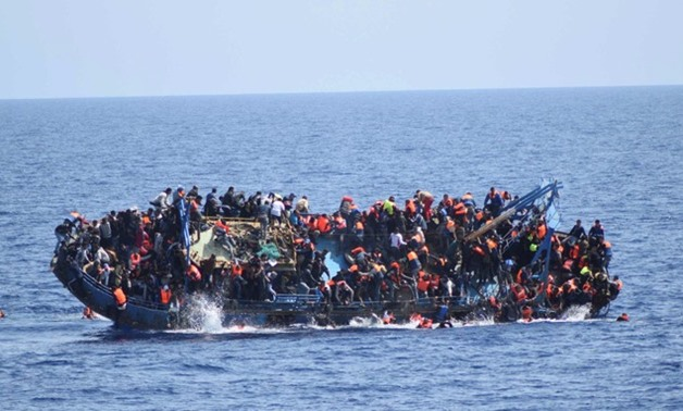 FILE-  Overcrowded boat capsized off the coast of Libya in May, 2016 - Reuters