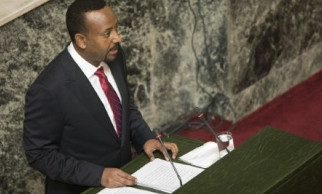 "© AFP/File / by Chris Stein | Parliament voted to lift the six-month decree early, citing the Ethiopia's ""relative stability and calm"" since Prime Minister Abiy Ahmed (pictured) took over in April, the state-run Ethiopian News Agency (ENA) reported"