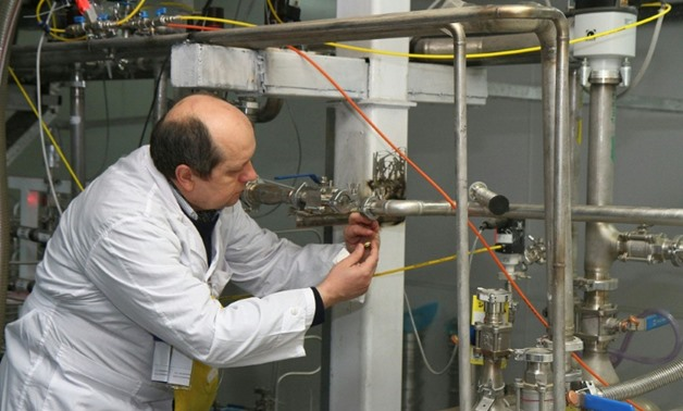 An International Atomic Energy Agency (IAEA) inspector in January 2014 disconnects cascades for 20 percent uranium production at the nuclear power plant of Natanz, some 300 kilometres south of Tehran