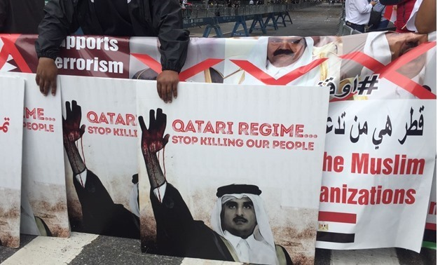 Anti-Qatar banners in protests outside the UN HQ in NY on Sept. 19, 2017 - Egypt Today