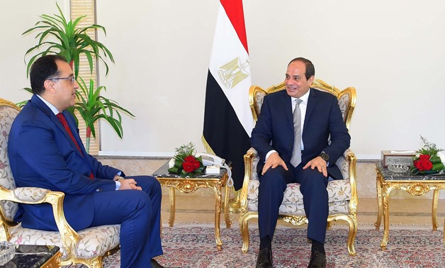 President Abdel Fatah al-Sisi talks with newly appointed Prime Minister Moustafa Madbouly on Thursday, June 7, 2018- press photot