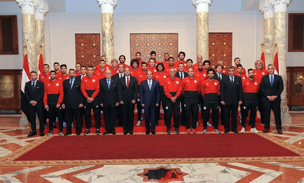FILE - President Abdel-Fatah al-Sisi meets the Egyptian national team's players and coaching staff