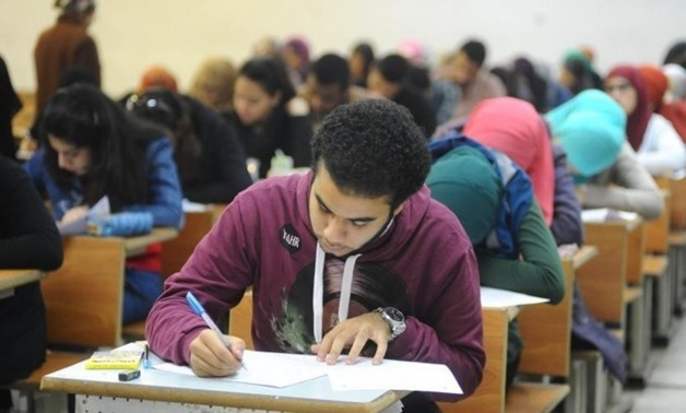 FILE - College students having an exam