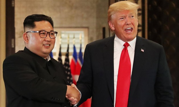 U.S. President Donald Trump and North Korea's leader Kim Jong Un shake hands after signing documents during a summit at the Capella Hotel on the resort island of Sentosa, Singapore June 12, 2018. REUTERS/Jonathan Ernst