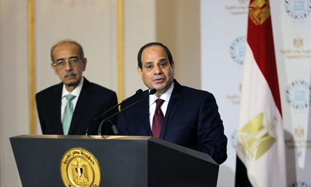 President Abdel Fatah al-Sisi (R) and former PM Sherif Ismail (L) during the Egyptian Family Iftar ceremony on June 12, 2018 – Press photo