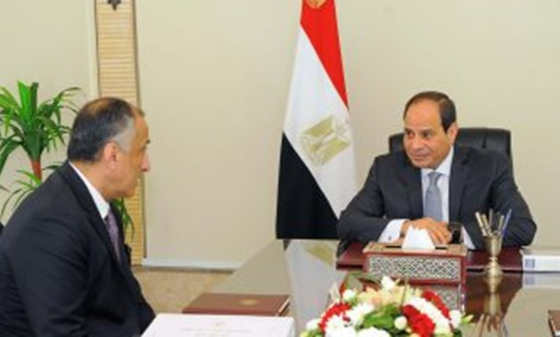 President Abdel Fatah al-Sisi during a meeting with Governor of the Central Bank of Egypt (CBE) Tareq Amer on Wednesday - Press Photo