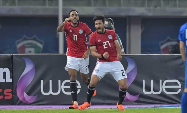 FILE - Ayman Ashraf celebrates scoring against Kuwait