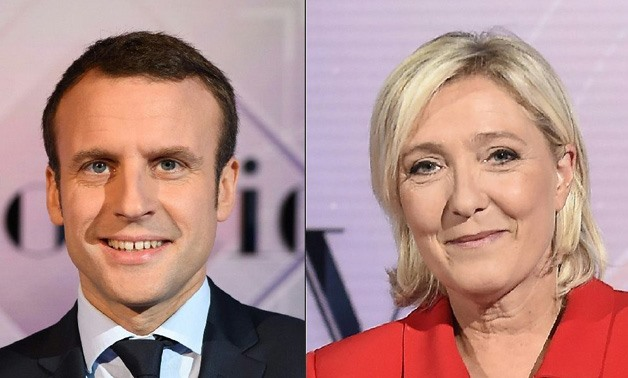 The latests show Macron (L) holding a hefty but narrowing lead over Le Pen (R) in the polls of 59 percent to 41 percent /Reuters