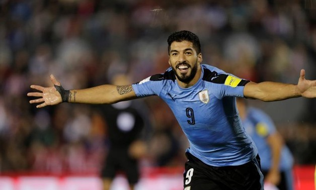 Uruguay's Luis Suarez celebrates after a goal against Paraguay. REUTERS/Mario Valdez