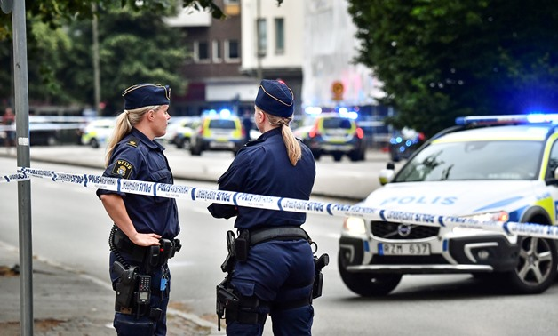 Police stand next to a cordon after a shooting on a street in central Malmo, Sweden June 18, 2018. TT News Agency/Johan Nilsson/via REUTERS ATTENTION EDITORS - THIS IMAGE WAS PROVIDED BY A THIRD PARTY. SWEDEN OUT. NO COMMERCIAL OR EDITORIAL SALES IN SWEDE