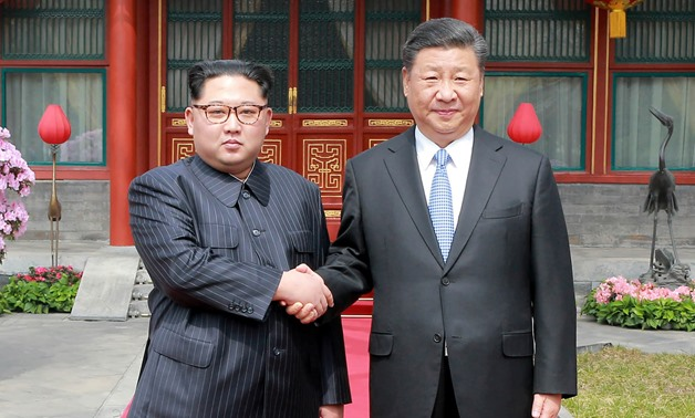 North Korean leader Kim Jong Un went to Beijing looking for a big-brother type and found one in Chinese President Xi Jinping. (KCNA/Reuters)