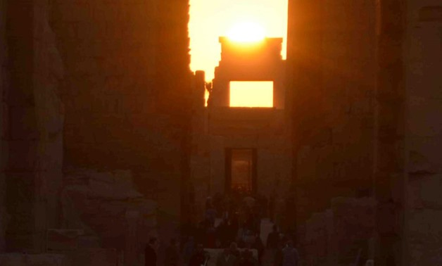 Sun sets from Karnak Temple's western gate on June 21