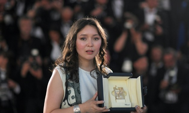 """Kazakh actress Samal Yeslyamova won international acclaim for her wrenching portrayal of a Central Asian single mother struggling for survival in Russia in Sergei Dvortsevoi's film """"Ayka""""-AFP/File / LOIC VENANCE"""