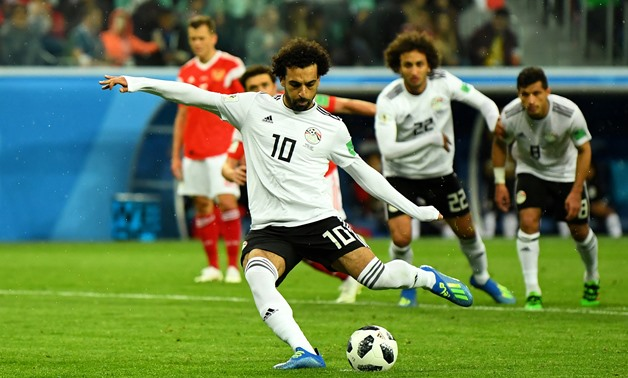 Soccer Football - World Cup - Group A - Russia vs Egypt - Saint Petersburg Stadium, Saint Petersburg, Russia - June 19, 2018 Egypt's Mohamed Salah scores their first goal from the penalty spot REUTERS/Dylan Martinez