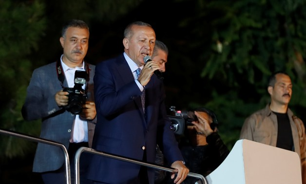 Turkish President Tayyip Erdogan addresses his supporters in Istanbul, Turkey June 24, 2018. REUTERS/Osman Orsal