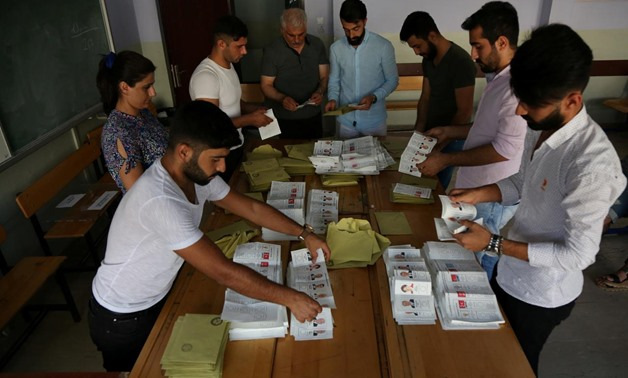 Ballots of Turkey's presidential and parliamentary elections are being counted at a polling station in Diyarbakir, Turkey June 24, 2018. REUTERS/Sertac Kayar