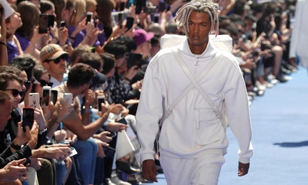 FILE PHOTO: Designer Virgil Abloh appears at the end of his Spring/Summer 2019 collection for Off-white fashion label during Mens' Fashion Week in Paris, France, June 20, 2018. REUTERS/Charles Platiau/File Photo