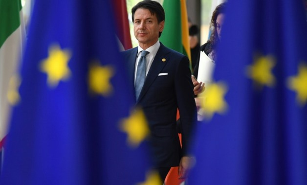 Italian Prime Minister Giuseppe Conte arrives at the EU summit threatening to block a joint statement on migration unless Italy gets more help