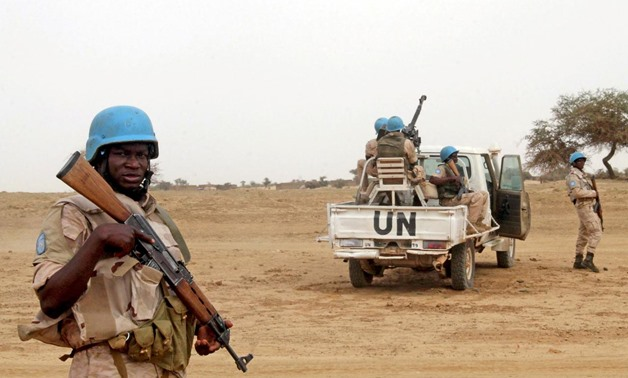 FILE PHOTO: UN peacekeepers stand guard in the northern town of Kouroume, Mali, May 13, 2015. Kourome is 18 km (11 miles) south of Timbuktu. REUTERS/Adama .