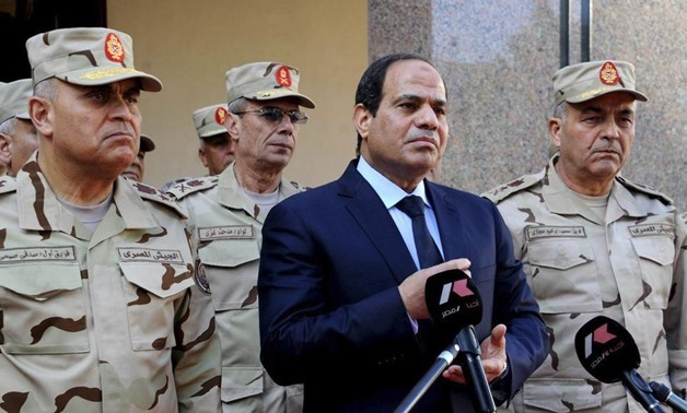 Egyptian president Abdel Fattah El Sisi is pictured talking to the media next to top military generals in Cairo on January 31, 2015. The Egyptian Presidency/Handout/Reuters