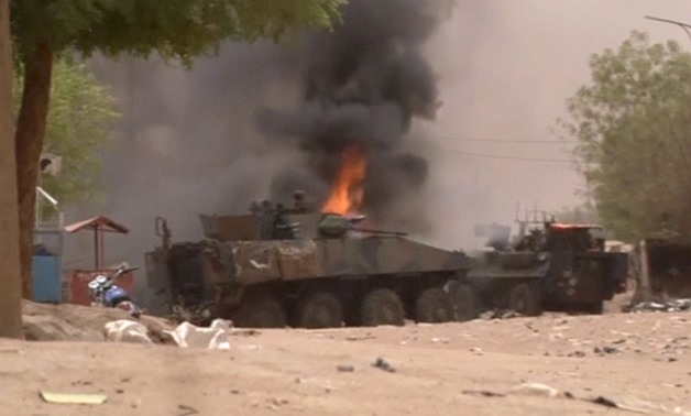 A still image taken from a video shows an armoured personnel carrier on fire after a car bomb attack in Gao, northern Mali July 1, 2018. REUTERS/via Reuters TV