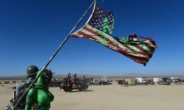Festivalgoers attend Wasteland Weekend in the high desert community of California City in the Mojave Desert, for the world's largest post-apocalyptic festival, on September 22, 2016