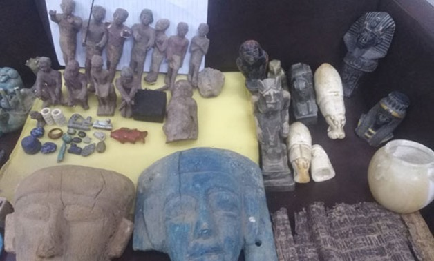Ancient antiquities seized by the police before smuggling from Minya, Upper Egypt - Press photo on April 24, 2018