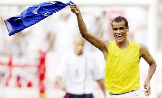 Rivaldo celebrates scoring against England at 2002 World Cup quarter finals, Reuters