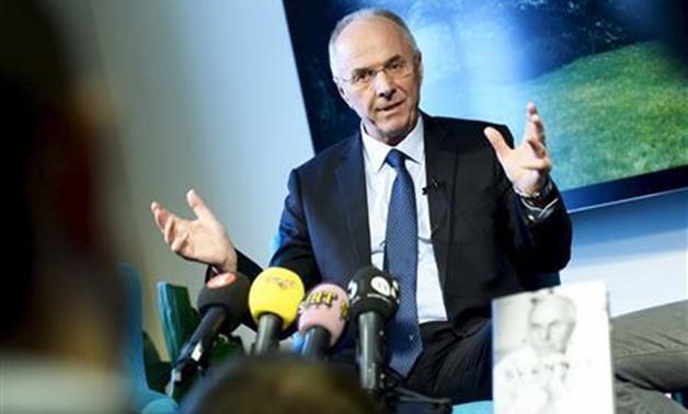 Soccer coach Sven-Goran Eriksson, manager of Chinese Super League team Guangzhou R&F, smiles during a news conference promoting his memoirs in Stockholm November 6, 2013. REUTERS/Claudio Bresciani/TT News Agency