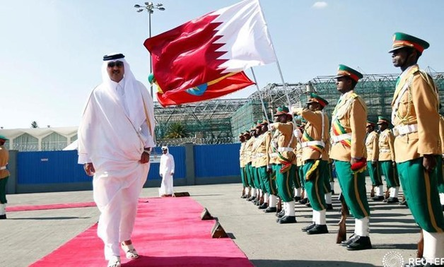 Qatari Emir Sheikh Tamim bin Hamad al-Thani inspects a guard of honor upon arriving - FILE