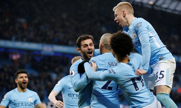 Man City Players celebrating scoring a goal, Reuters-Andrew Yates