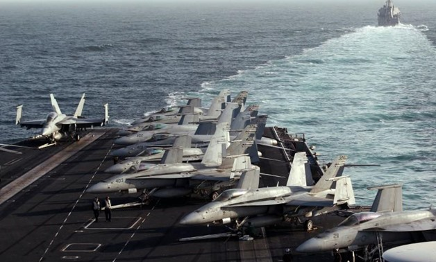 FILE PHOTO: The Sterett Destroyer escorts the Nimitz-class aircraft carrier USS Abraham Lincoln (CVN 72) during a transit through the Strait of Hormuz, February 14, 2012. REUTERS/Jumana El Heloueh/File Photo