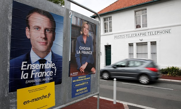 Posters of the candidates for the 2017 French presidential election - Reuters